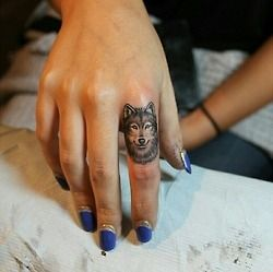 Great wolf tattoo on finger