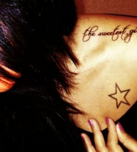 Great words and star tattoo on shoulder