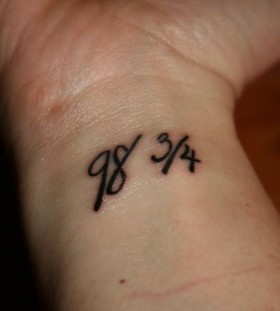 Great wrist number tattoo on arm