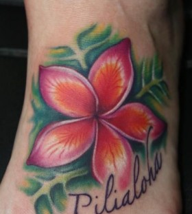 Green and red flower hawaiian style tattoo