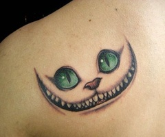 Green eye cat tattoo on arm
