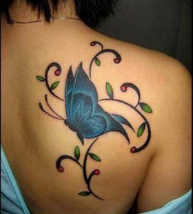 Green leaf and blue butterfly tattoo on shoulder