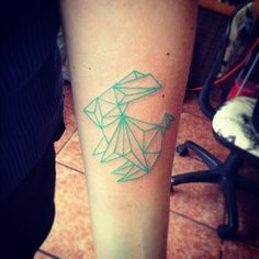 Green lovely origami tattoo on arm