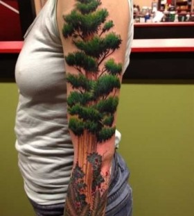 Green lovely tree tattoo on arm