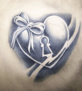 Heart with bow keyhole tattoo