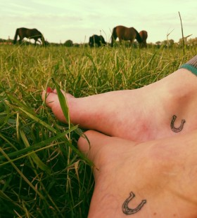 Horses, red nails and horse shoe tattoo