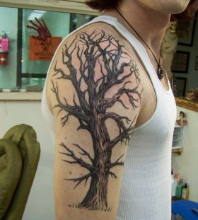 Huge amazing tree tattoo on arm