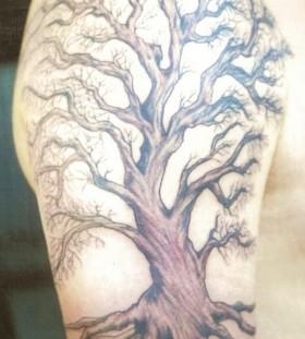 Huge brown tree tattoo on arm