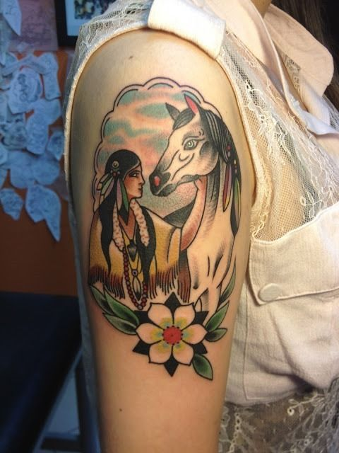 Indian man and horse tattoo on arm