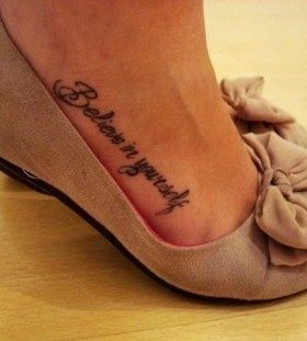 Inspirational quote tattoo with shoes