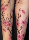 Japanese branch cherry tattoo on arm