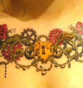 Key and flower tattoo on chest