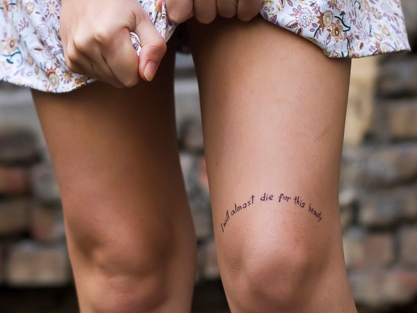 Knee lovely quote tattoo on leg