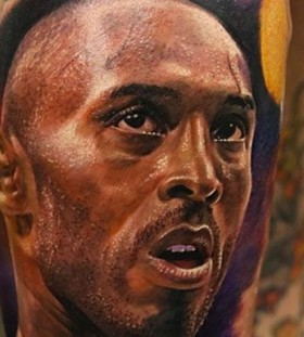 Kobe Bryant's face tattoo on leg