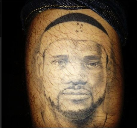 LeBron James' face tattoo on leg