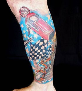 Left blue car tattoo on leg