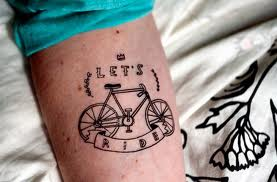 Let's ride bicycle tattoo on arm