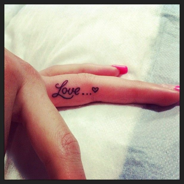 Love heart quote tattoo on finger