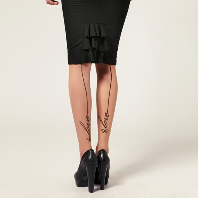 Love word and line tattoo on leg