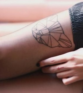Lovely bear origami tattoo on leg