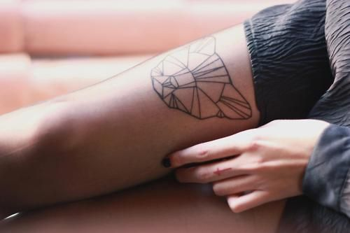 Lovely bear origami tattoo on leg