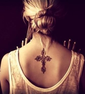 Lovely black back cross tattoo