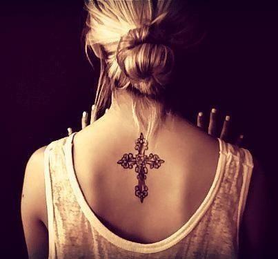 Lovely black back cross tattoo