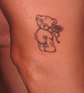 Lovely black bear tattoo on leg and pink flower