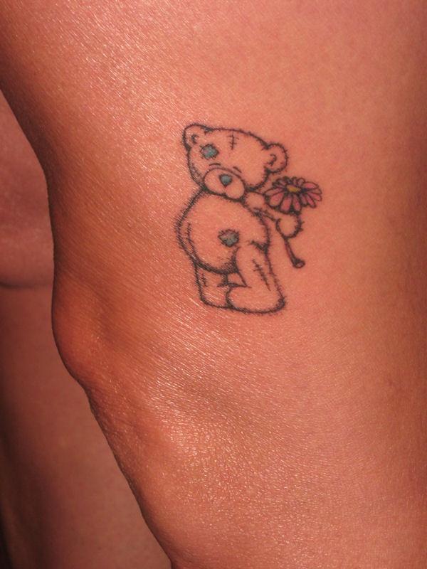 Lovely black bear tattoo on leg and pink flower