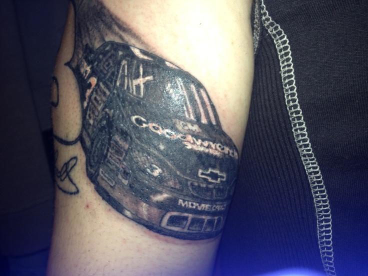Lovely black car tattoo on arm