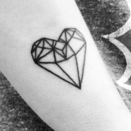 Lovely black heart ornaments tattoo