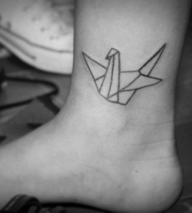 Lovely black origami tattoo on leg