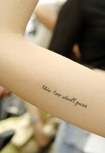 Lovely black quote tattoo on arm