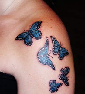 Lovely blue butterfly tattoo on shoulder