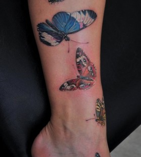 Lovely butterflies tattoo by Dimitry Samohin