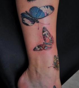 Lovely butterflies tattoo by Dimitry Samohin