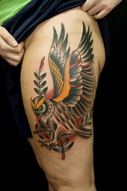 Lovely colorful bird tattoo on leg