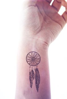 Lovely dream catcher tattoo on wrist