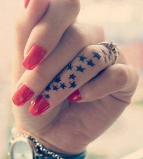 Lovely finger star tattoo on arm