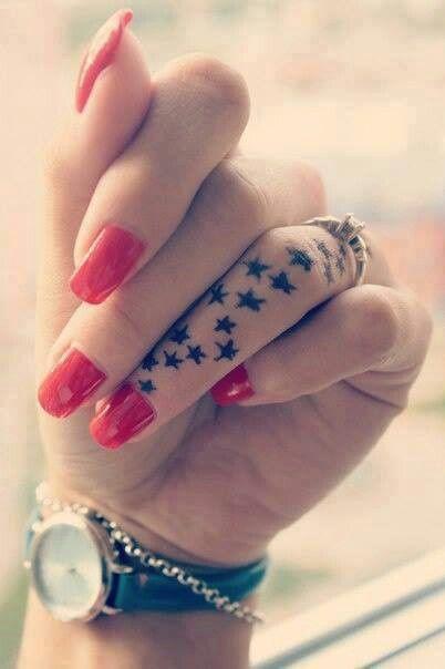 Lovely finger star tattoo on arm