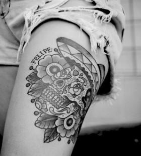 Lovely flowers and skull tattoo on leg