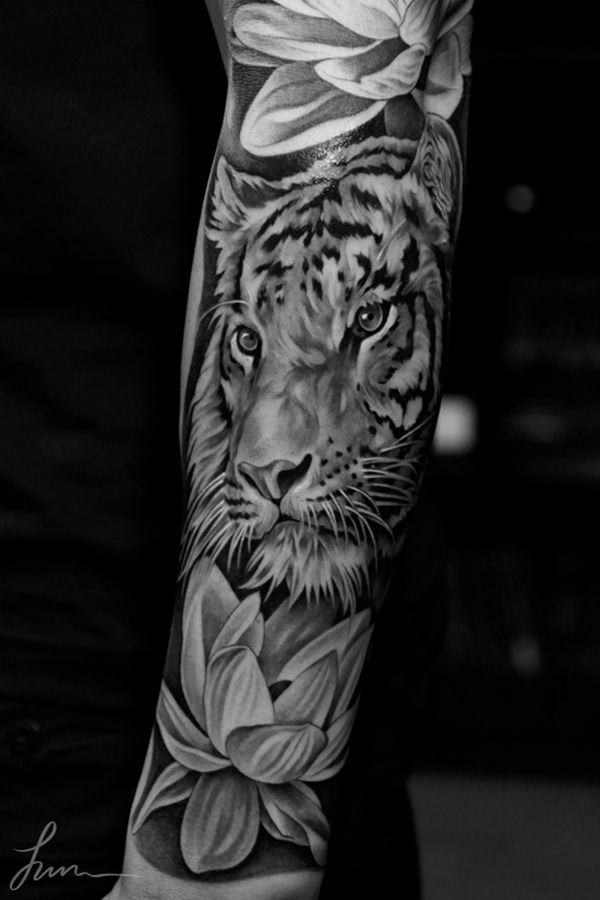 Lovely flowers and tiger tattoo on arm