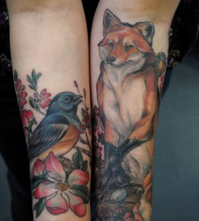 Lovely fox and bird tattoo on arm