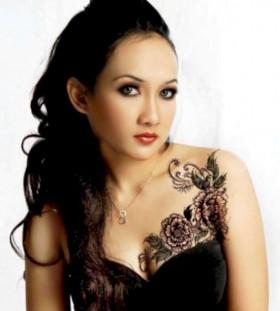 Lovely girl and flower tattoo on chest