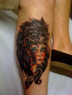 Lovely girl and wolf tattoo on leg