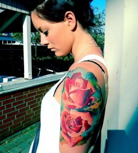 Lovely girl red rose tattoo on arm