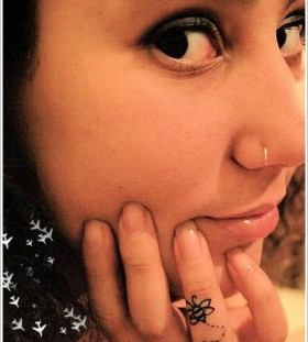 Lovely girl tattoo on finger