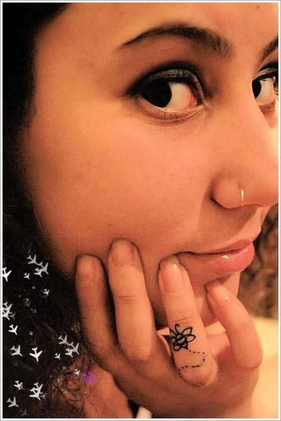 Lovely girl tattoo on finger