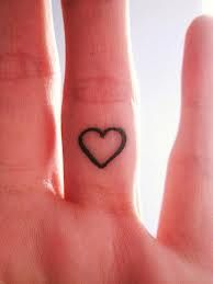 Lovely heart and love tattoo on arm