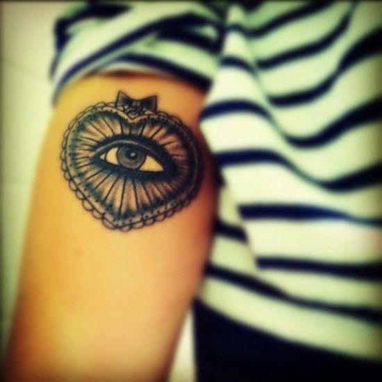 Lovely heart eye tattoo on arm